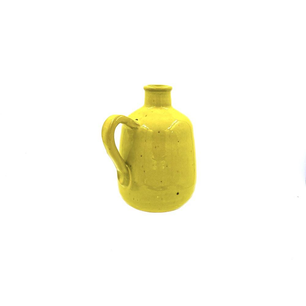 yellow glazed pottery pitcher