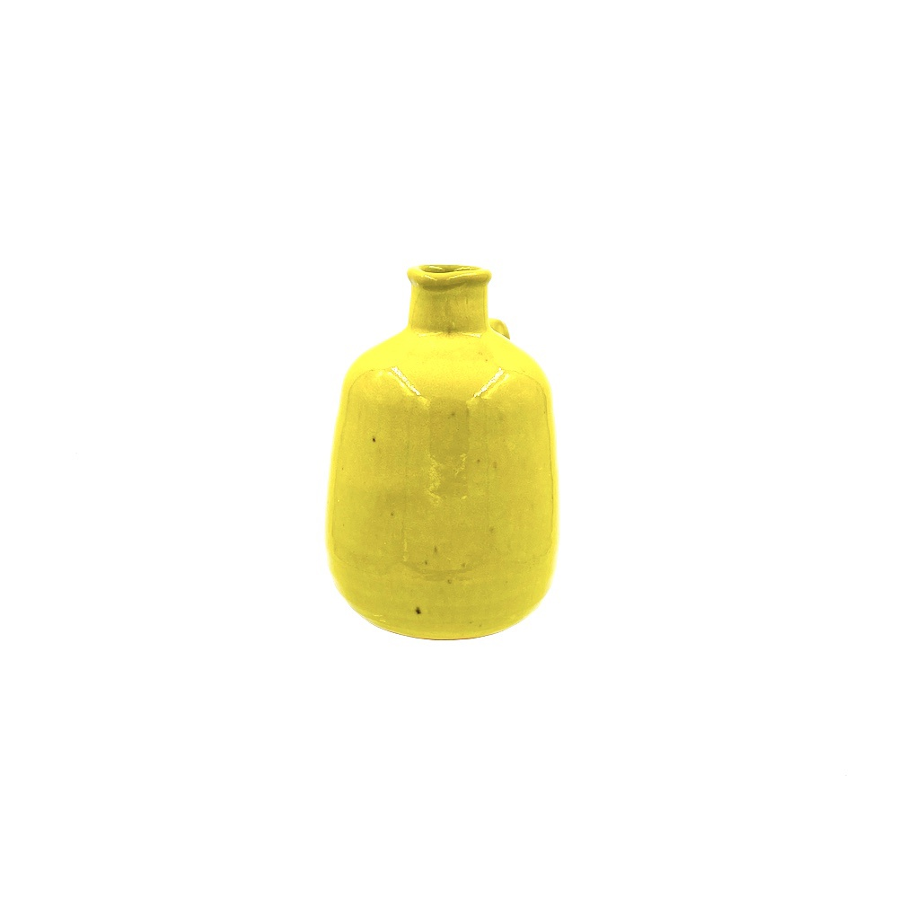 bright yellow pottery pitcher