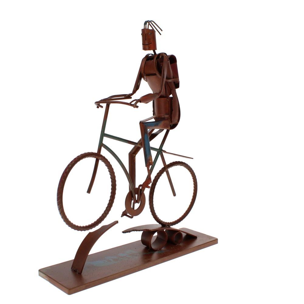 biker boy metal sculpture angled view