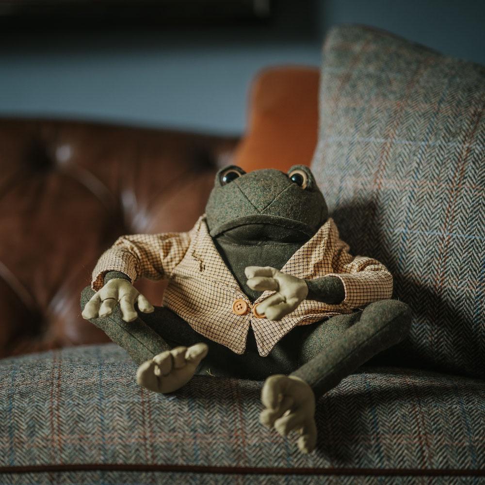 Frog doorstop dressed in jacket