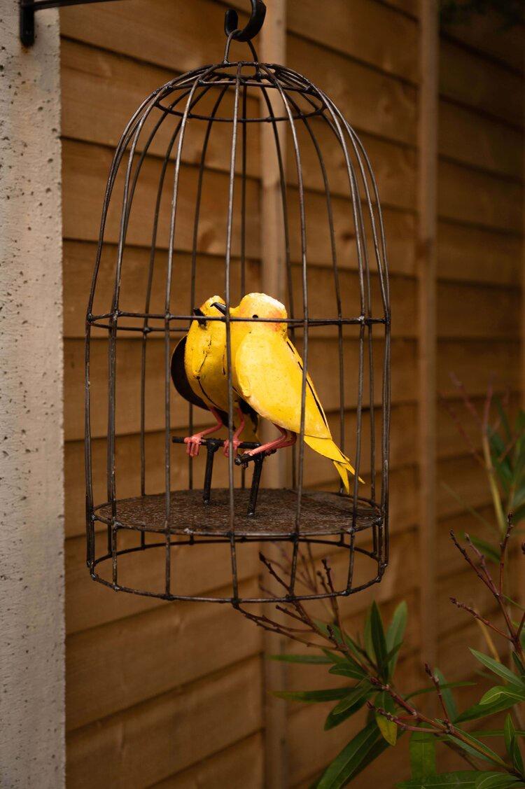 metal canaries in a bird cage outdoor sculpture
