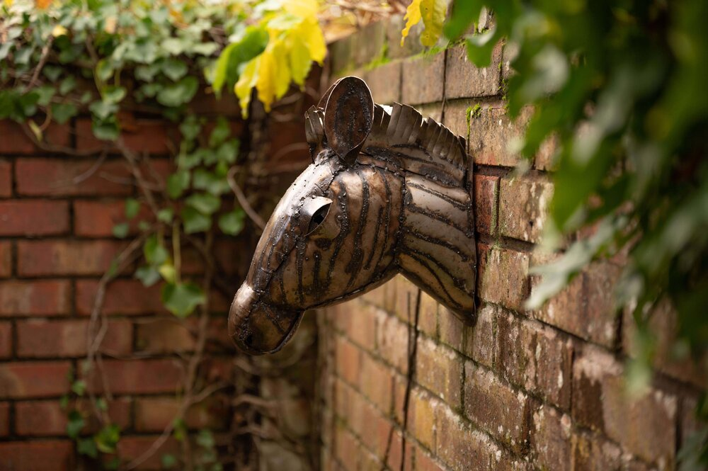 recycled metal zebra head garden wall ornament side view