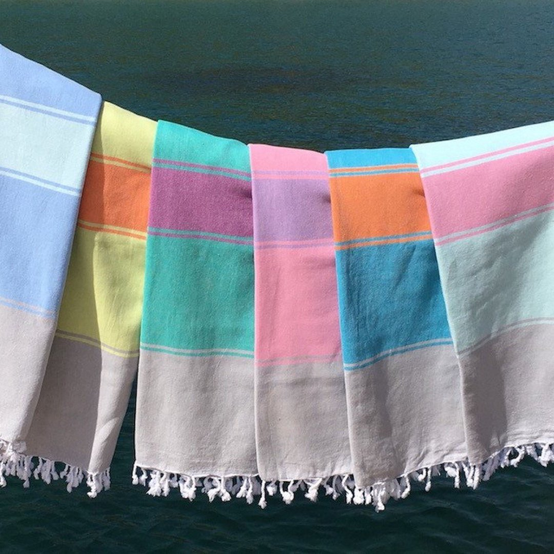 collection of striped throws with fringe