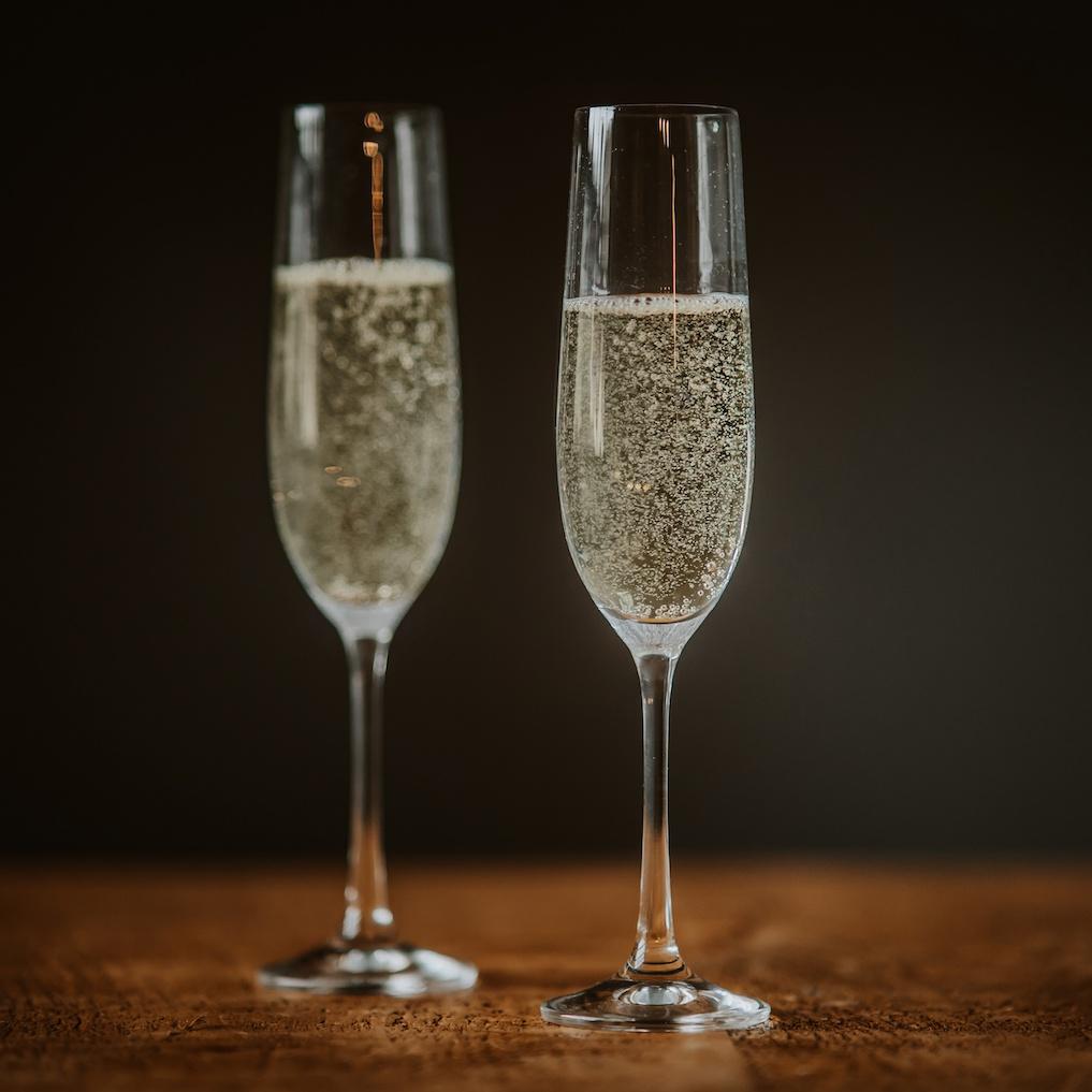 Dartington Champagne Flutes filled