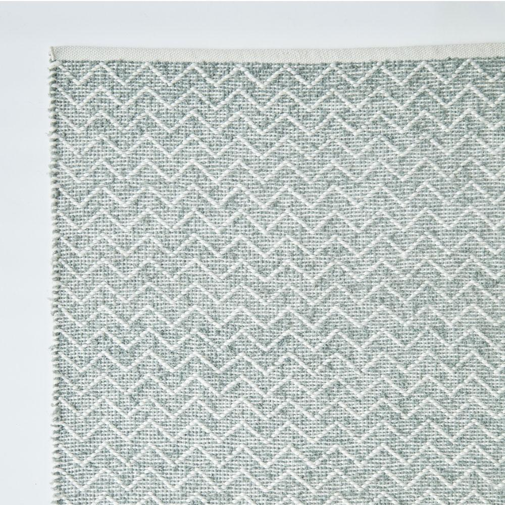 rug made from recycled bottles in Dove Grey, corner section