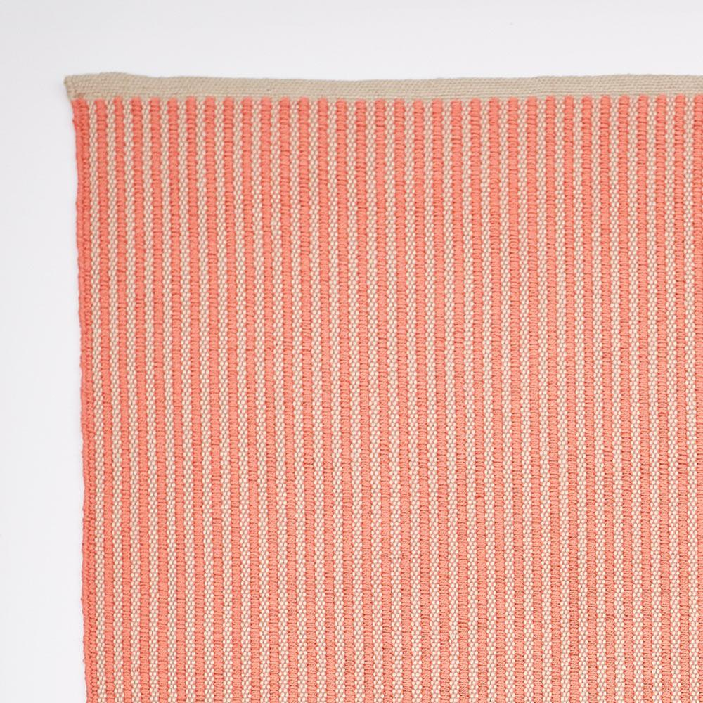 rug made from recycled bottles, coral striped, corner section