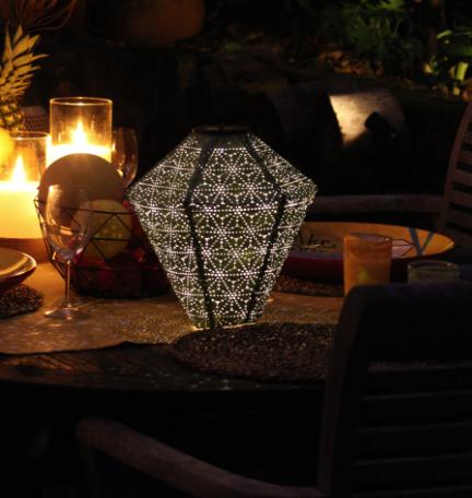 solar lantern green diamond lit at night