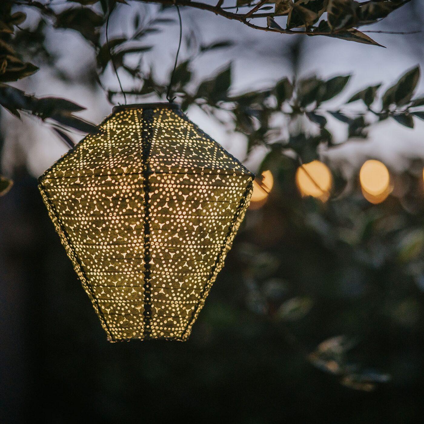 solar lantern green diamond close up lit at night
