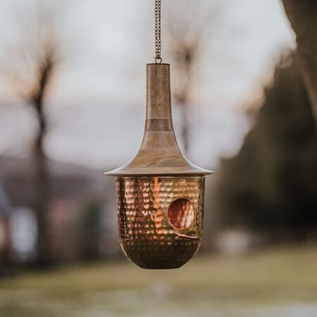 copper bird house with mango wood roof