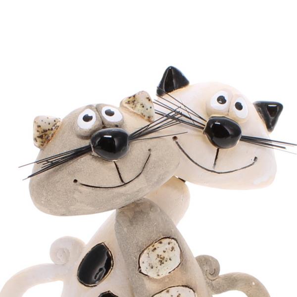 pair of ceramic cats